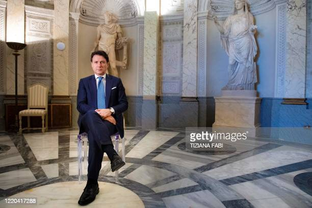 Italy's Prime Minister Giuseppe Conte poses during a photo session within an interview with AFP at Villa Pamphilj in Rome on June 16 as the country...