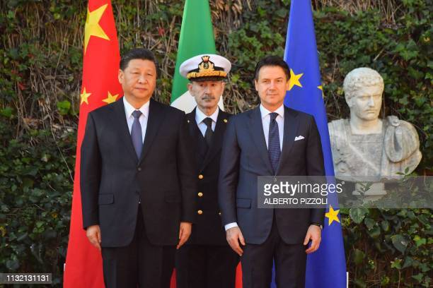 Italys Prime Minister Giuseppe Conte poses with China's President Xi Jinping upon his arrival for their meeting at Villa Madama in Rome on March 23,...