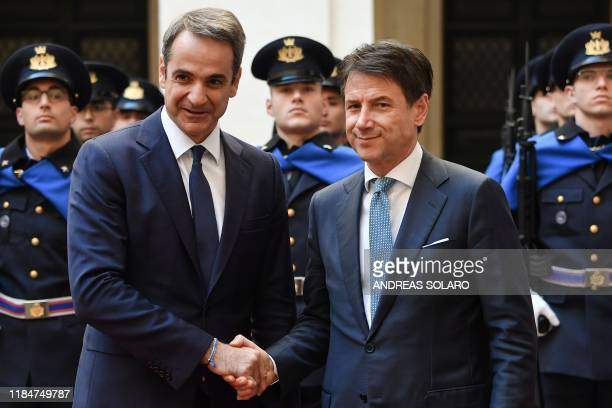 Italy's Prime Minister Giuseppe Conte shakes hand with his Greek counterpart Kyriakos Mitsotakis upon his arrival for their meeting at Palazzo Chigi...
