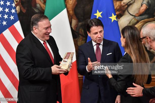 Italy's Prime Minister Giuseppe Conte speaks and gestures towards Italian journalist Alice Martinelli from Italy's Mediaset television programm Le...