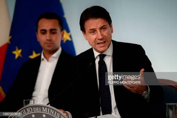 Italy's Prime Minister Giuseppe Conte speaks as Italy's Deputy Prime Minister and Minister of Economic Development Labour and Social Policies Luigi...
