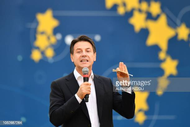 Italy's Prime Minister Giuseppe Conte speaks during a convention of the governing coalition's populist Five Star Movement on October 21 2018 in Rome