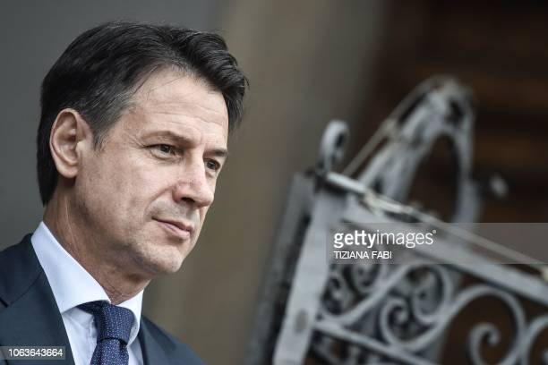 Italys Prime Minister Giuseppe Conte stands at attention upon the arrival of Qatar's Sheikh for their meeting at Villa Phamphili in Rome on November...