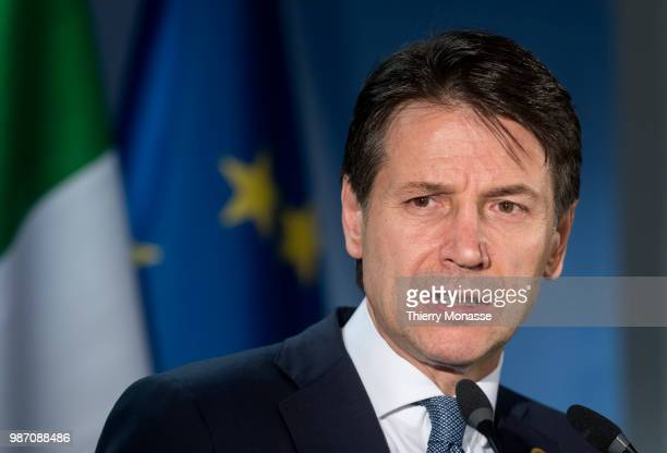 Italy's prime minister Giuseppe Conte talks to the media at the end of an EU Summit at European Council on June 29 2018 in Brussels Belgium