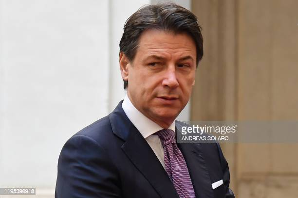 Italy's Prime Minister Giuseppe Conte waits for the arrival of his Albanian counterpart for their meeting on January 23, 2020 at Palazzo Chigi in...