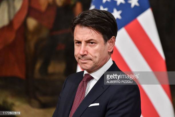Italy's Prime Minister Giuseppe Conte waits for the arrival of US Secretary of State Mike Pompeo for their meeting on October 1, 2019 at Palazzo...