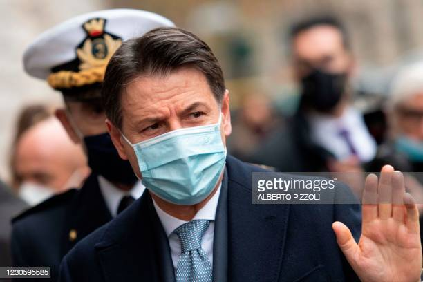 Italy's Prime Minister Giuseppe Conte waves as he arrives to take part on January 15, 2021 in a ceremony to replace the Commander General of the...