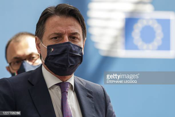 Italy's Prime Minister Giuseppe Conte, wearing a protective face mask, arrives for the fourth day of an EU summit at the European Council building in...