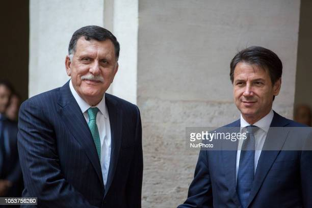 Italy's Prime Minister Giuseppe Conte welcomes the Chairman of the Presidential Council of Libya, Fayez al-Sarraj at the Chigi palace in Rome,...
