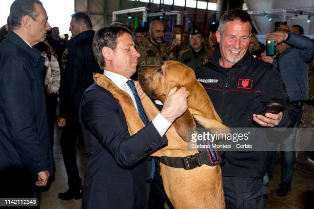 Italy's Prime Minister Giuseppe Conte with Zagor a dog of the Carabinieri with whom the head of government entertained at Pratica di Mare after...