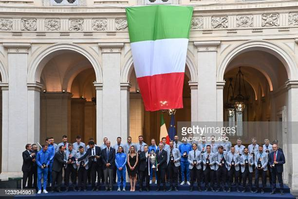 Italy's Prime Minister, Mario Draghi and President of the Italian Football Federation , Gabriele Gravina hold the UEFA EURO 2020 trophy as they pose...