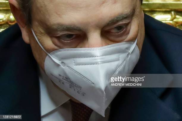 Italy's Prime Minister Mario Draghi attends a debate at the Senate in Rome on February 17 before submitting his government to a vote of confidence.