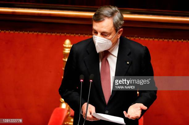 Italy's Prime Minister Mario Draghi delivers a speech during a debate at the Senate on February 17, 2021 in Rome, before submitting his government to...