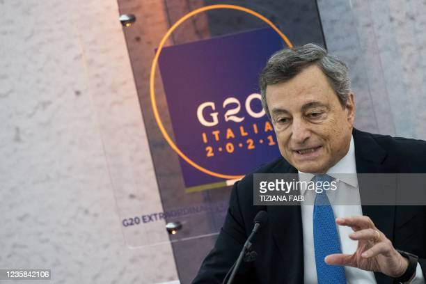 Italy's Prime Minister Mario Draghi gestures as he speaks during a press conference following a G20 virtual summit focused on Afghanistan in Rome, on...