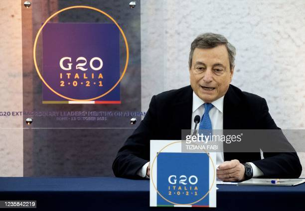 Italy's Prime Minister Mario Draghi speaks during a press conference following a G20 virtual summit focused on Afghanistan in Rome, on October 12,...