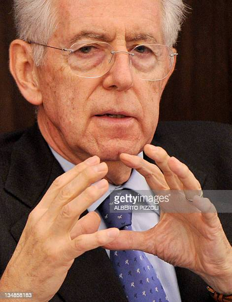 Italy's prime minister Mario Monti gestures as he speaks during a press conference after the ministers council for the approval of the new measures...