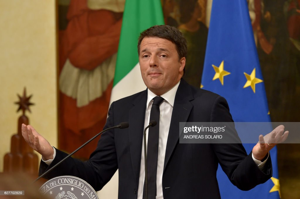 Italy's Prime Minister Matteo Renzi announces his resignation during a press conference at the Palazzo Chigi following the results of the vote for a referendum on constitutional reforms, on December 5, 2016 in Rome. 'My experience of government finishes here,' Renzi told a press conference after the No campaign won what he described as an 'extraordinarily clear' victory in the referendum on which he had staked his future. / AFP / Andreas SOLARO /