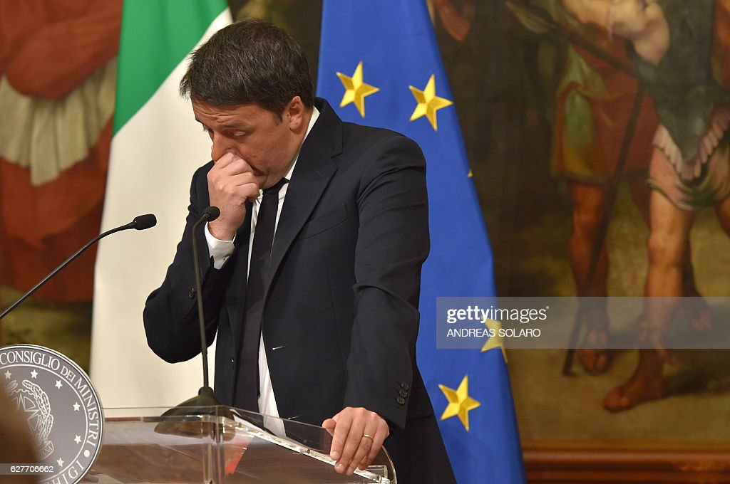 CORRECTION - Italy's Prime Minister Matteo Renzi announces his resignation during a press conference at the Palazzo Chigi following the results of the vote for a referendum on constitutional reforms, on December 5, 2016 in Rome. 'My experience of government finishes here,' Renzi told a press conference after the No campaign won what he described as an 'extraordinarily clear' victory in the referendum on which he had staked his future. / AFP / Andreas SOLARO / The erroneous mention[s] appearing in the metadata of this photo by Andreas SOLARO has been modified in AFP systems in the following manner: [December 5, 2016] instead of [December 4, 2016]. Please immediately remove the erroneous mention[s] from all your online services and delete it (them) from your servers. If you have been authorized by AFP to distribute it (them) to third parties, please ensure that the same actions are carried out by them. Failure to promptly comply with these instructions will entail liability on your part for any continued or post notification usage. Therefore we thank you very much for all your attention and prompt action. We are sorry for the inconvenience this notification may cause and remain at your disposal for any further information you may require.