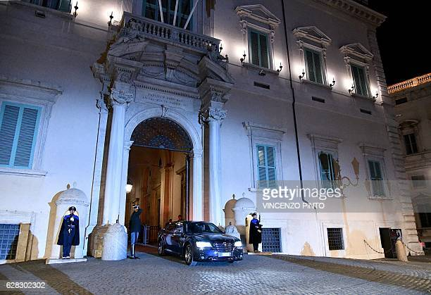 Italy's Prime Minister Matteo Renzi leaves by car the Quirinale Presidential Palace on December 7 2016 in Rome after presenting his official...
