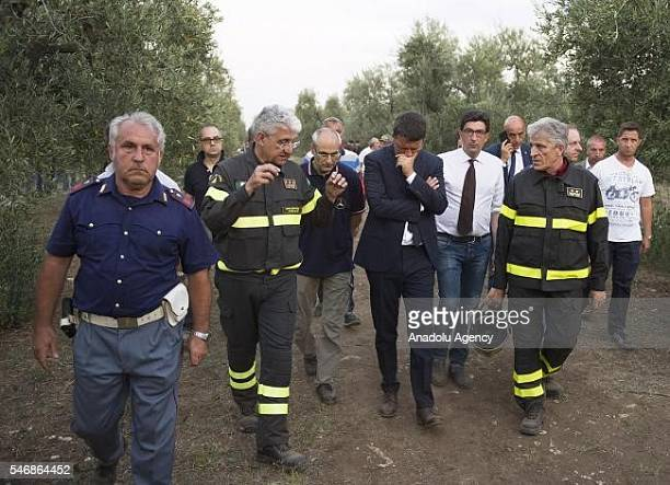 Italy's Prime Minister Matteo Renzi visits site where at least 27 people died in a headon collision between two passenger trains near Corato in the...