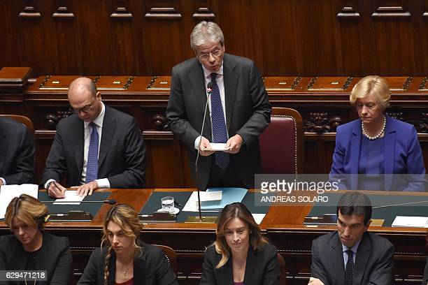 Italy's prime Minister Paolo Gentiloni delivers a speech at the Chamber of Deputies before a confidence vote to the new government on December 13...