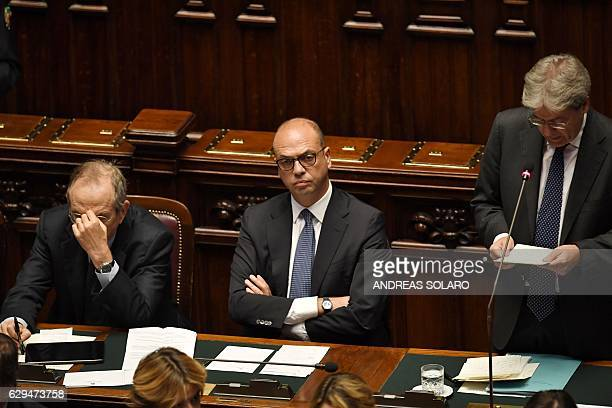 Italy's Prime Minister Paolo Gentiloni delivers a speech next to Economy and Finance Minister Pier Carlo Padoan and Foreign Affairs Minister Angelino...