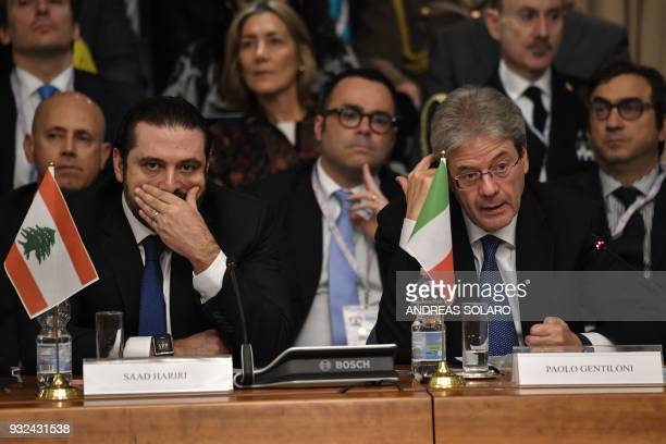 Italys Prime Minister Paolo Gentiloni delivers his speech next to Lebanese Prime Minister and Leader of the Future Movement Party Saad Hariri during...