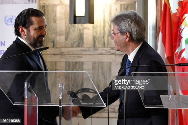 Italy's Prime Minister Paolo Gentiloni shakes hands with Lebanese Prime Minister and Leader of the Future Movement Party Saad Hariri at the end of a...