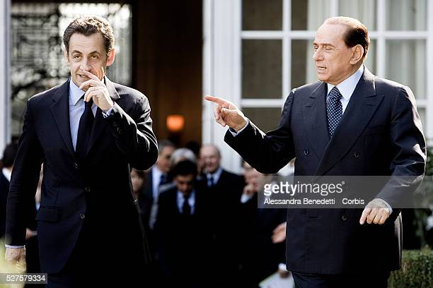 Italy's Prime Minister Silvio Berlusconi and French President Nicolas Sarkozy arrive at Villa Madama for a bilateral meeting