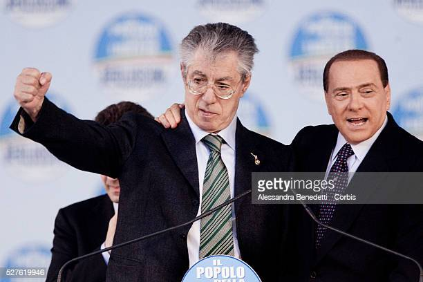 """Italy's Prime Minister Silvio Berlusconi and leader of the """"Lega Nord"""" Umberto Bossi gesture as they speak to supporters of the centre-right Popolo..."""