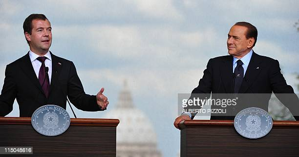 Italy's Prime Minister Silvio Berlusconi and Russia's President Dmitry Medvedev give a press conference after a meeting on June 2, 2011 at Villa...