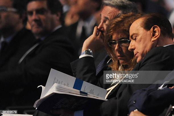 Italy's Prime Minister Silvio Berlusconi and the head of the Italian employers group the Confindustria, Emma Marcegaglia chat during a congress of...