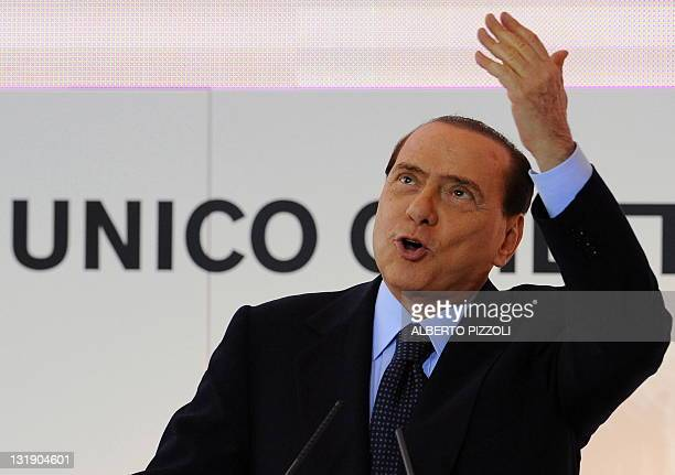 Italy's Prime minister Silvio Berlusconi speaks during a meeting about the new hubs of Rome's Fiumicino and Milan's Malpensa airports on October 14,...