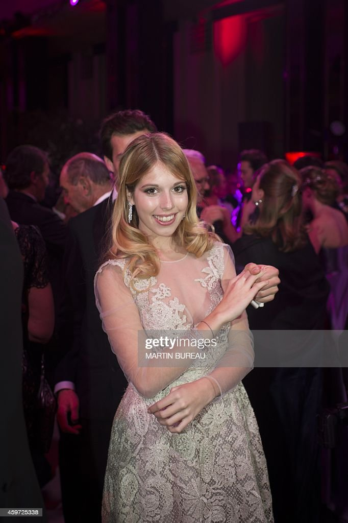 Italy's Princess Larissa Windish Graetz, the daughter of Archduchess Sophie of Austria and Mariano Hugo, Prince of Windish Gretz, dances with her partner, Italy's Tommaso Crimi, during the 22nd Debutantes Ball (le Bal des Débutantes) on November 29, 2014 at the Palais de Chaillot in Paris.