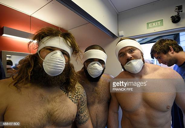 Italy's prop Martin Castrogiovanni and flanker Samuela Vunisa pose before entering a cryotherapy chamber at the University of Surrey in Guildford...