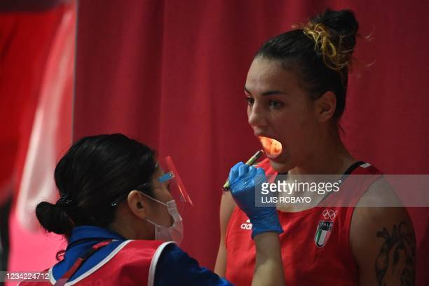 Italy's Rebecca Nicoli undergoes a medical check-up as she fights Mexico's Esmeralda Falcon Reyes during their women's light preliminaries boxing...