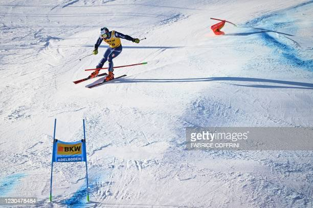 Italy's Riccardo Tonetti misses the gate and is disqualified during the round 2 of the Men's Giant Slalom race during the FIS Alpine ski World Cup on...