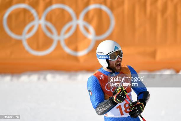 Italy's Riccardo Tonetti reacts after competing in the Men's Giant Slalom at the Jeongseon Alpine Center during the Pyeongchang 2018 Winter Olympic...