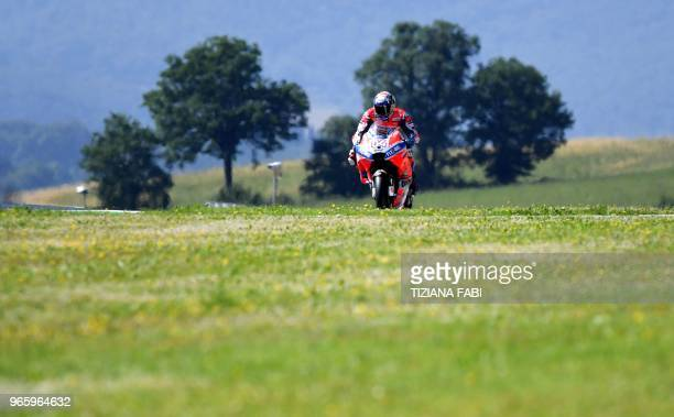 TOPSHOT Italy's rider Andrea Dovizioso takes part in the free practice of the Moto GP of the Italian Grand Prix at the Mugello track on June 2 2018