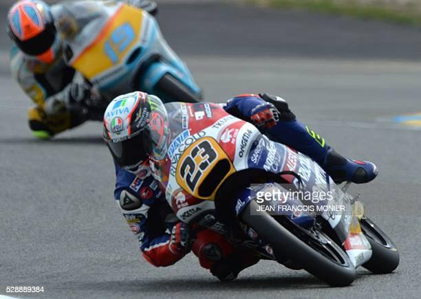 Italy's rider Niccolo Antonelli competes on his Honda OngettaRivacold N��23 ahead Argentina's rider Gabriel Rodrigo on his KTM RBA Racing Team N��19...