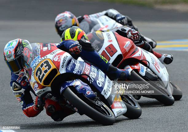 Italy's rider Niccolo Antonelli competes on his Honda OngettaRivacold N��23 ahead Malaysia's Khairul Idham Pawi on his Honda Team Asia N��89 and...