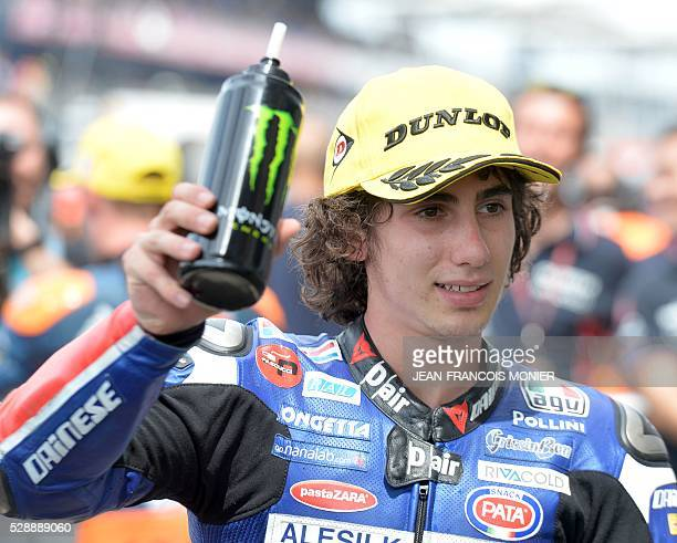 Italy's rider Niccolo Antonelli pole celebrates after the Moto3 qualifying cession of the French motorcycling Grand Prix ahead of the French...