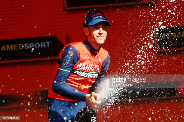 Italy's rider of team Bahrain Merida Vincenzo Nibali celebrates on the podium after winning the 16th stage of the 100th Giro d'Italia Tour of Italy...