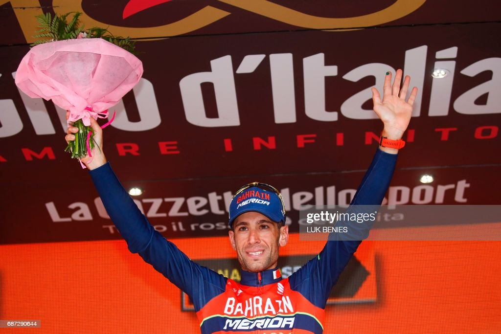 Italy's rider of team Bahrain - Merida Vincenzo Nibali celebrates on the podium after winning the 16th stage of the 100th Giro d'Italia, Tour of Italy, cycling race from Rovetta to Bormio on May 23, 2017. Italy's Vincenzo Nibali pipped Spanish rival Mikel Landa to victory in a dramatic 16th stage of the Giro d'Italia that saw drained race leader Tom Dumoulin struggle to retain the pink jersey. / AFP PHOTO / Luk BENIES