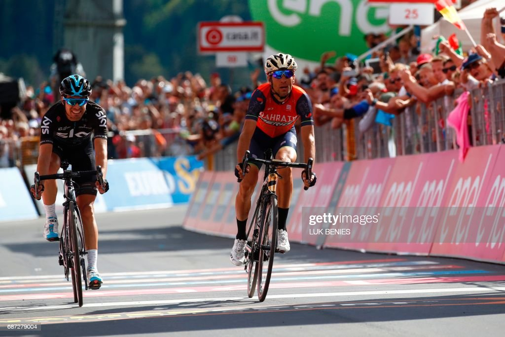 Italy's rider of team Bahrain - Merida Vincenzo Nibali (R) crosses the finish line ahead Spain's Mikel Landa of team Sky and won the 16th stage of the 100th Giro d'Italia, Tour of Italy, cycling race from Rovetta to Bormio on May 23, 2017. / AFP PHOTO / Luk BENIES