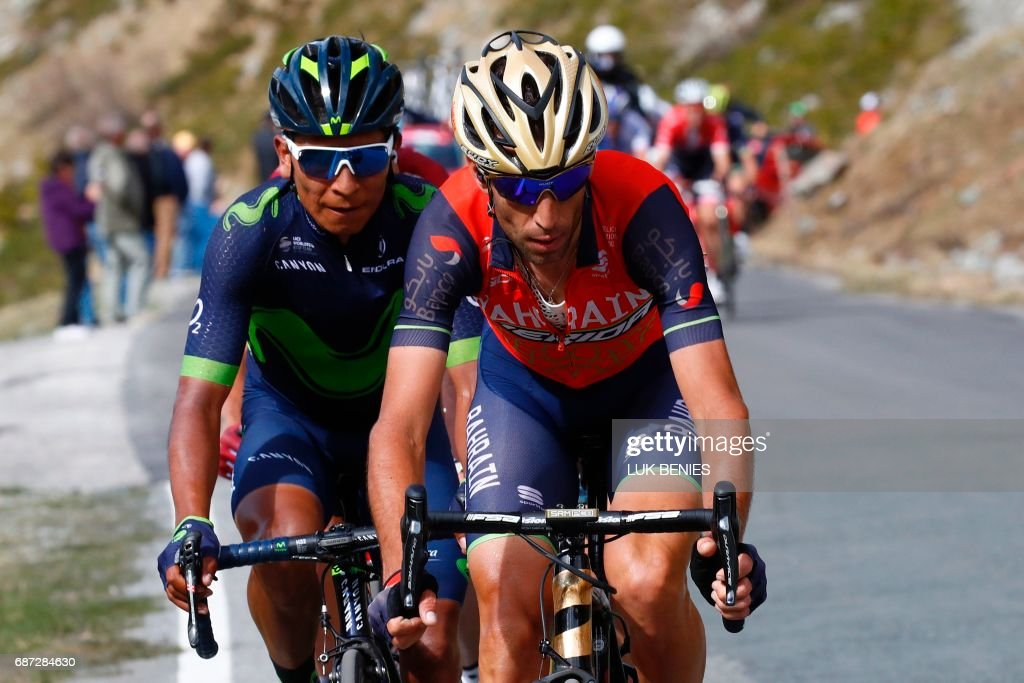 Italy's rider of team Bahrain - Merida Vincenzo Nibali (R) rides ahead Colombia's Nairo Quintana of team Movistar during the 16th stage of the 100th Giro d'Italia, Tour of Italy, cycling race from Rovetta to Bormio on May 23, 2017. Italy's Vincenzo Nibali pipped Spanish rival Mikel Landa to victory in a dramatic 16th stage of the Giro d'Italia that saw depleted race leader Tom Dumoulin retain the pink jersey. / AFP PHOTO / Luk BENIES
