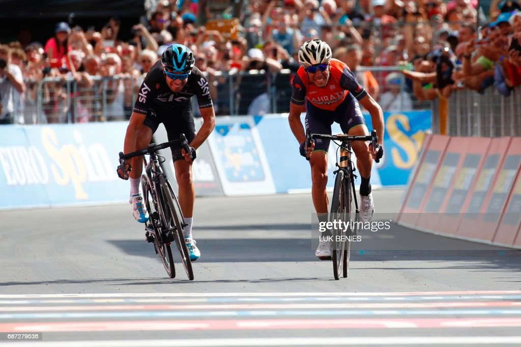 TOPSHOT - Italy's rider of team Bahrain - Merida Vincenzo Nibali (R) sprints to cross the finish line ahead Spain's Mikel Landa of team Sky during the 16th stage of the 100th Giro d'Italia, Tour of Italy, cycling race from Rovetta to Bormio on May 23, 2017. / AFP PHOTO / Luk BENIES