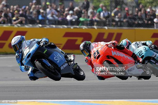 Italy's rider Romano Fenati competes on his KTM Sky Racing Team VR46 N°5 ahead of Spain's rider Ana Carrasco on his KTM RBA Racing Team N°22 and...