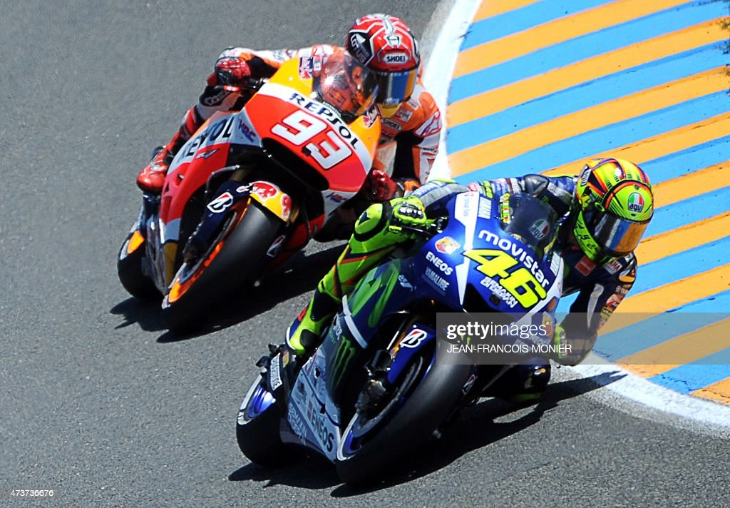 Italy's rider Valentino Rossi competes on his Movistar Yamaha MOTOGP N°46 (R) ahead of Spain's rider Marc Marquez on his Repsol Honda N°93 during the MotoGP race of the French motorcycling Grand Prix on May 17, 2015 in Le Mans, western France. Spain's Jorge Lorenzo Lorenzo won ahead of Italy's Valentino Rossi and Italy's Andrea Dovizioso.