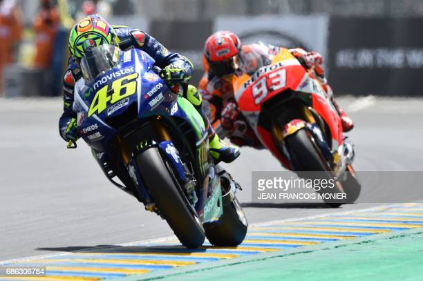 Italy's rider Valentino Rossi competes on his Movistar Yamaha MOTOGP N°46 ahead of Spain's rider Marc Marquez on his Repsol Honda Team MOTOGP N°93...